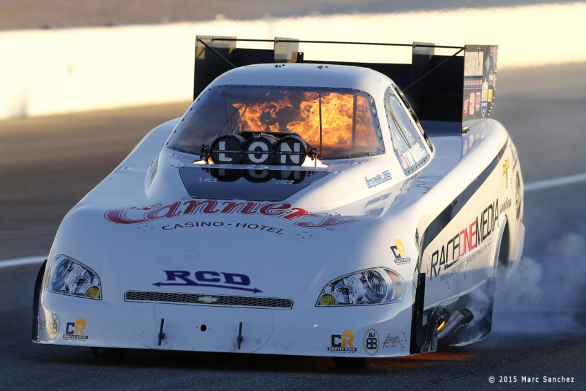 2015 October 31: Tim Gibbons (765 FC) NHRA Funny Car rolls down the track in flames during the Toyota NHRA Nationals at The Strip at Las Vegas Motor Speedway in Las Vegas, Nevada.  (Photo by Marc Sanchez/Icon Sportswire)