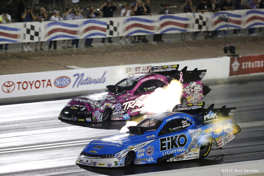 2015 October 31: Courtney Force (4 FC) John Force Racing Chevrolet Camaro NHRA Funny Car and John Force (2 FC) Chevrolet Camaro NHRA Funny Car during the Toyota NHRA Nationals at The Strip at Las Vegas Motor Speedway in Las Vegas, Nevada.  (Photo by Marc Sanchez/Icon Sportswire)