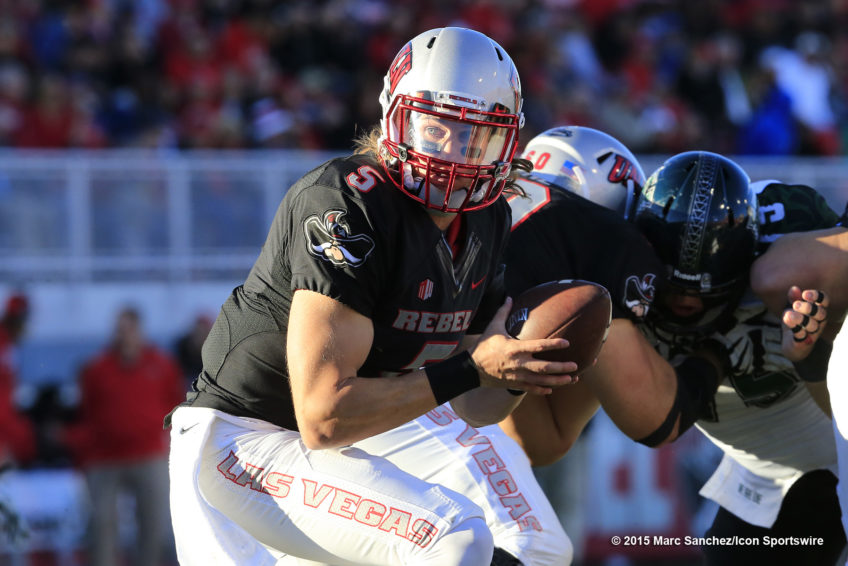 2015 November 07: Blake Decker (5) UNLV quarterback looks to hand off the ball during a game against the Hawaii Rainbow Warriors at Sam Boyd Stadium in Las Vegas, Nevada.  The UNLV Rebels would defeat the Hawaii Rainbow Warriors 41-21.(Photo by Marc Sanchez/Icon Sportswire)
