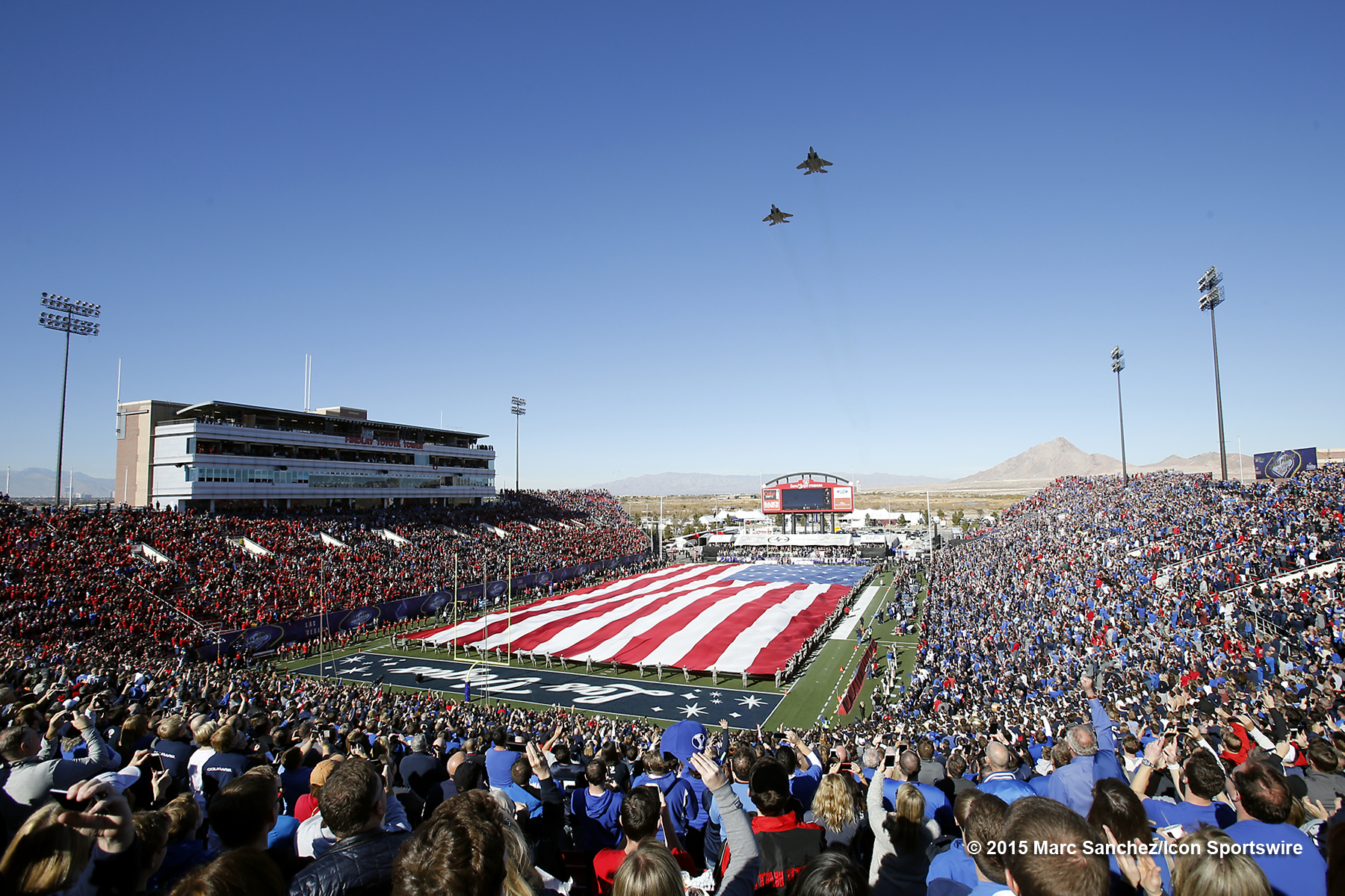 2015 December 19: Fans watch as two F-15 fighter jets fly over the field during the Royal Purple Las Vegas Bowl at Sam Boyd Stadium in Las Vegas, Nevada.