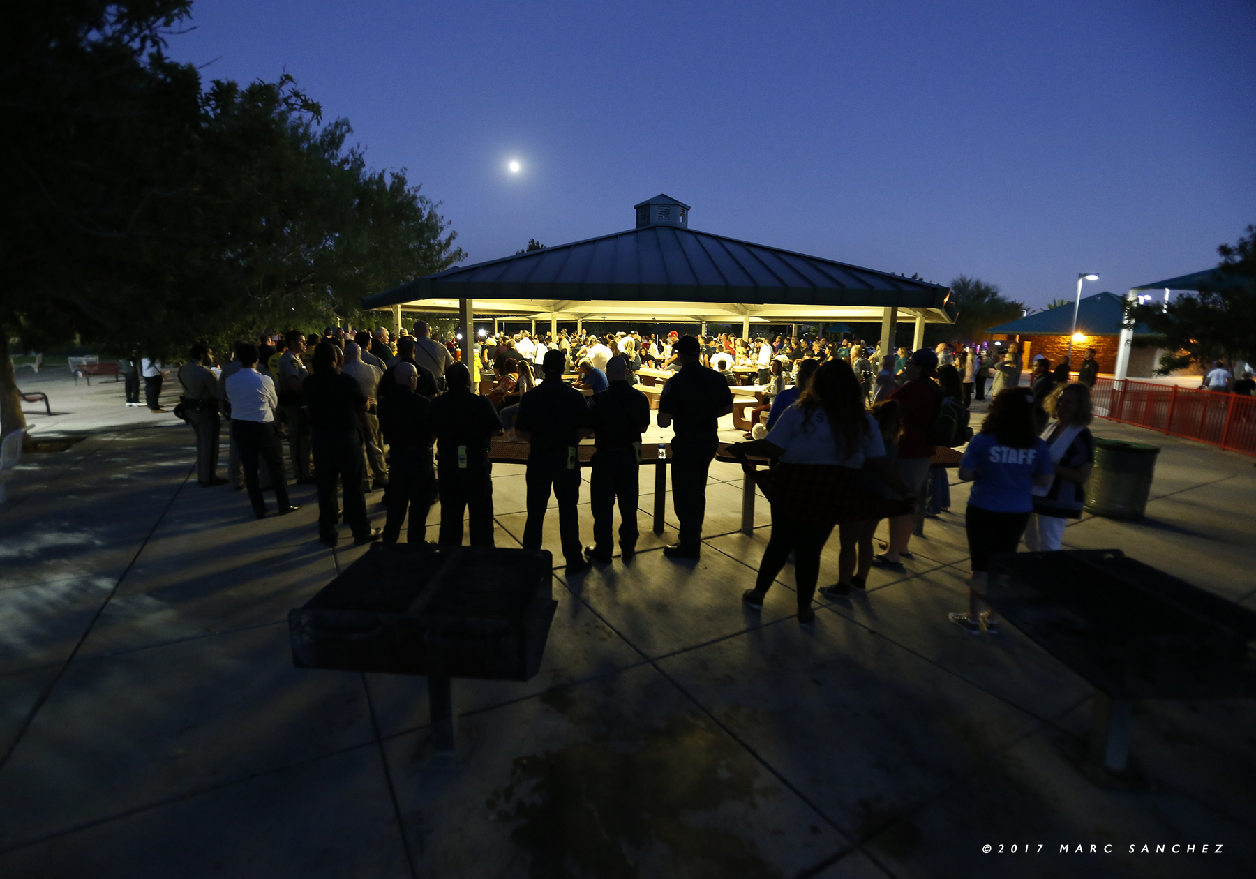 People attend a prayer vigil held at Mountain Crest Park for the victims of Sunday night's shooting on October 3, 2017, in Las Vegas, Nevada. The gunman opened fire from a room on the 32nd floor of the Mandalay Bay Resort and Casino on the Route 91 Harvest country music festival, leaving at least 58 people dead and more than 500 injured. The massacre is one of the deadliest mass shooting events in U.S. history. (Photo by Marc Sanchez)