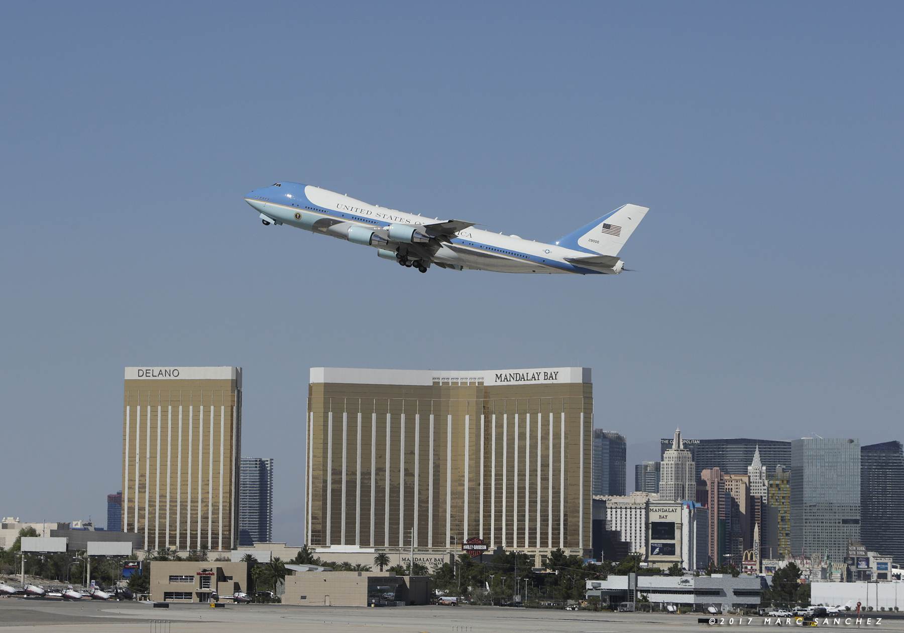 Image of Air Force One with US President Donald Trump and First Lady Melania Trump depart McCarran International Airport in Las Vegas October 4, 2017, with Mandalay Bay Resort in the background.